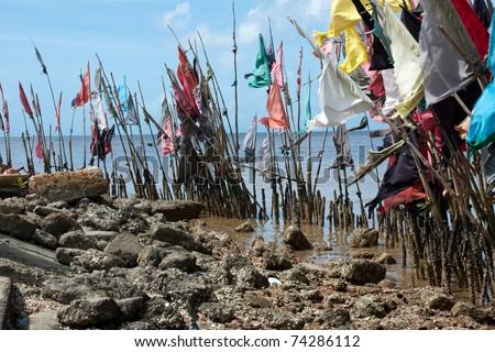 hindu spiritual flags near temple - stock photo
