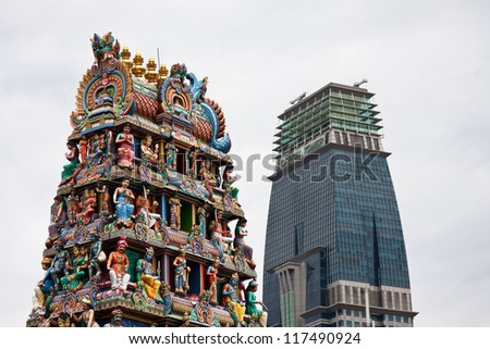 Hindu temple with modern building in the background, China Town, Singapore - stock photo