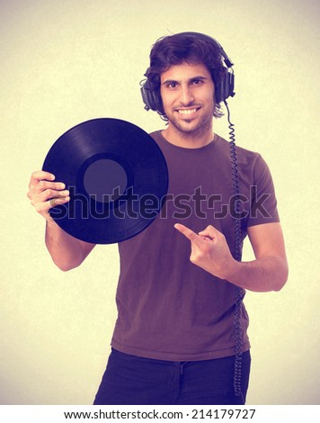 Hindu young man with headphones and vinyl