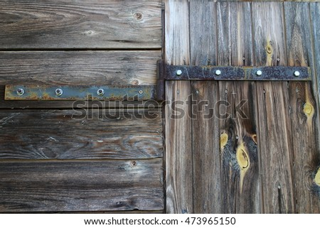 Hinge with screws on wooden door