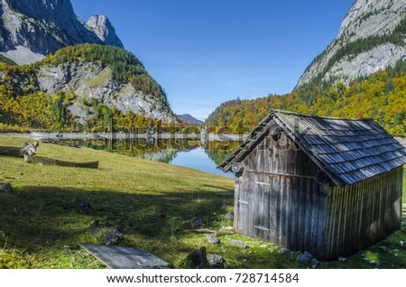 Hinterer Gosausee Alps mountains Austria lake fall colors colorful blue sky sun wooden lake house