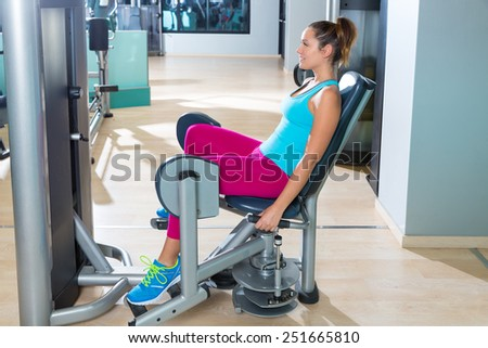 Hip abduction woman exercise at gym indoor opening legs workout - stock photo