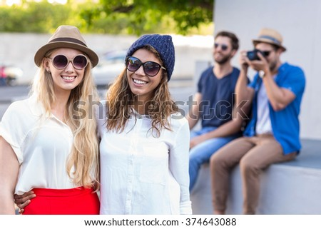 Hip friends taking a picture in the streets
