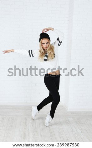 Hip hop dancer dancing on wall background - stock photo