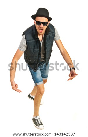 Hip hop man with hat gesturing and screaming isolated on white background