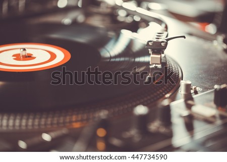 Hip hop party,turntable vinyl record player,analog sound technology for DJ playing digital music.Close up.Technology for professional dj studio,concert,event or party.Audio equipment for disc jockey