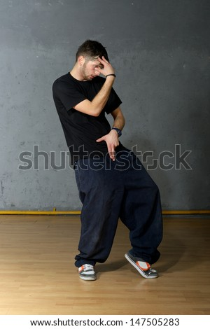 Hip-hop style dancer showing his dancing element