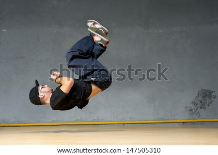 Hip-hop style dancer showing his dancing element - stock photo