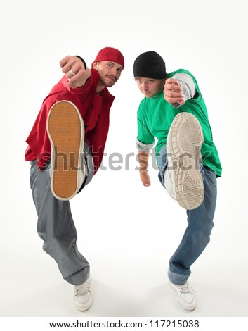 hip-hop style dancers posing on isolated background - stock photo