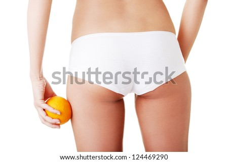 Hip, legs, abdomen and orange in hand. Cellulite, liposuction ,woman weight loss control concept