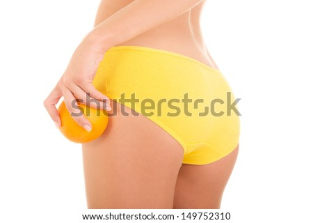 Hip, legs, abdomen and orange in hand. Cellulite, liposuction ,woman weight loss control concept  - stock photo