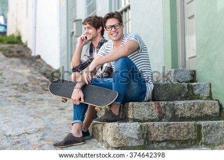 Hip men sitting on steps in the city