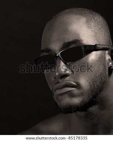 Hip muscular black man in sunglasses