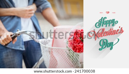 Hip young couple going for a bike ride against valentines day greeting - stock photo