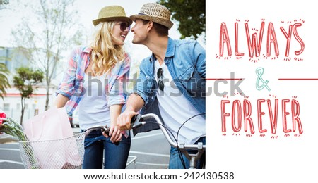 Hip young couple on a bike ride against always and forever - stock photo