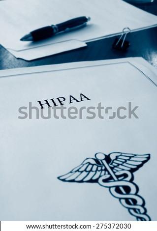HIPAA health care document in duo tone blue                                - stock photo