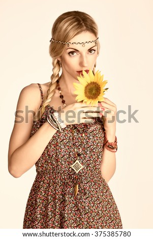 Hippie boho woman with sunflower. Beauty young playful positive blonde, pigtails, ethnic accessories relax. Floral sundress, romantic style.Attractive loving girl. Unusual creative, people,copyspace - stock photo