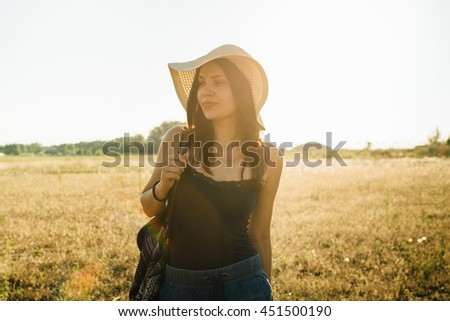 Hippie girl walking in nature, enjoying sunny day