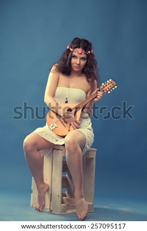 hippie girl with flowers on the head with Baubles. vintage retro