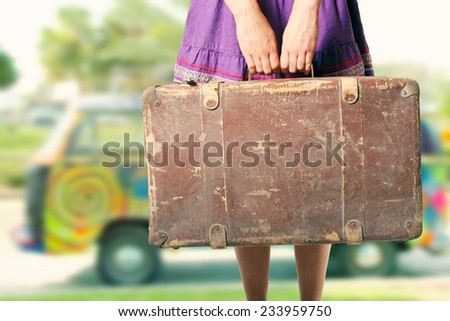 hippie girl with old suitcase on a road trip - stock photo