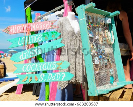 Hippie market with signs and accessory on the beach..