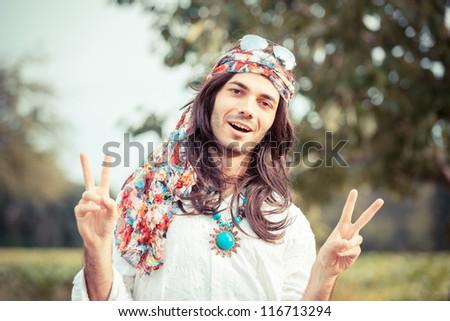 Hippie Portrait showing Peace Sign - stock photo