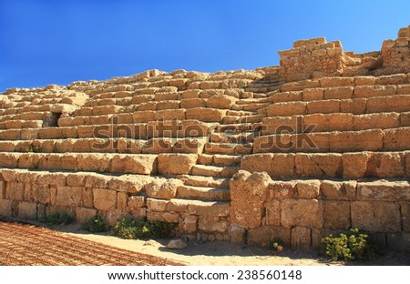 Hippodrome steps and seat ruins in Caesarea Maritima National Park, a city and harbor built by Herod the Great about 25-13 BC. The archaeological ruins are on the Mediterranean coast of Israel. - stock photo