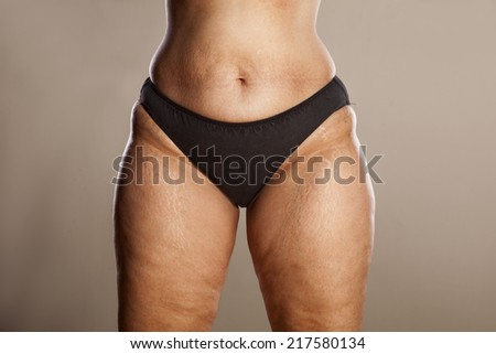 hips of a very thick woman in black panties - stock photo