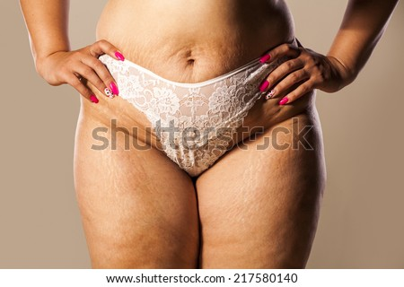 hips of a very thick woman in white panties - stock photo