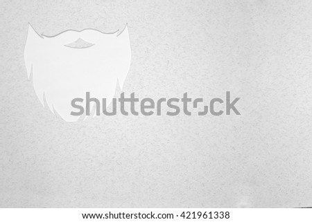 Hipster beard cut out from gray textured paper with copy space