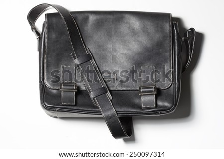 Hipster black leather handbag on white. Tredy accessory - stock photo