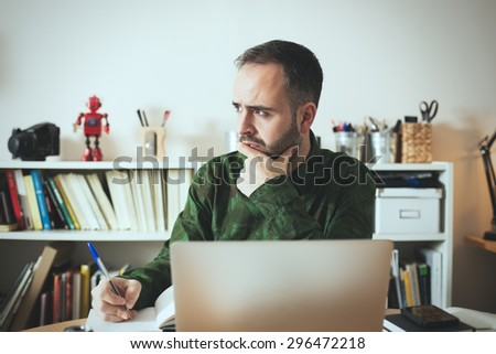 Hipster businessman thinking about new business ideas. - stock photo