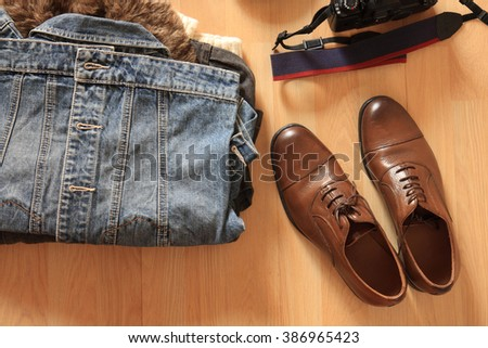 hipster clothes and accessories on a wooden background
