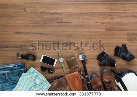 hipster clothes and accessories on a wooden background, View from above with copy workspace for design work - stock photo
