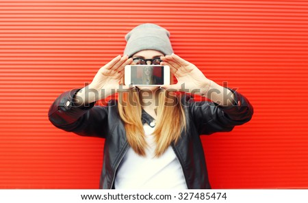 Hipster cool girl taking picture on smartphone self-portrait, screen view - stock photo