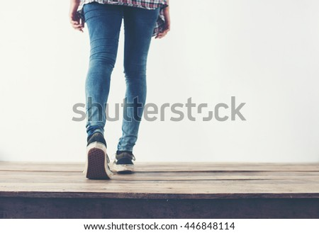 hipster cool woman feet with black sneakers, soft vintage toned colors.
