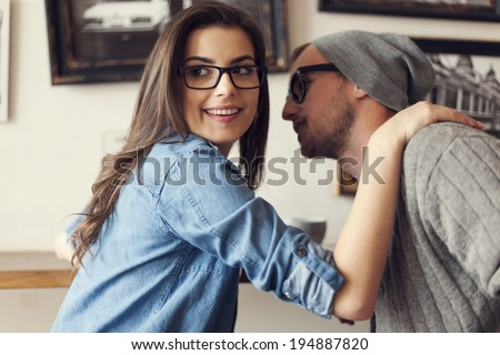 Hipster couple flirting at cafe   - stock photo