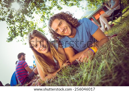 Hipster couple smiling at camera at a music festival