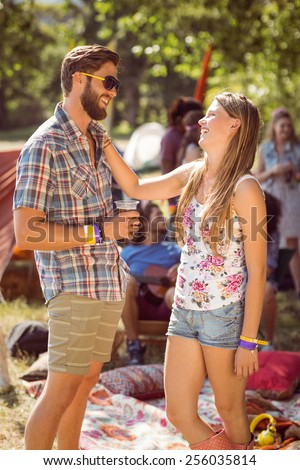 Hipster friends chatting on campsite at a music festival - stock photo
