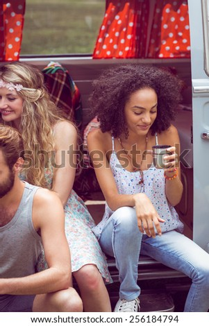 Hipster friends in camper van at festival on a summers day - stock photo