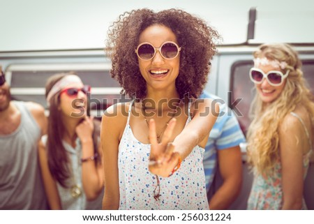 Hipster friends smiling at camera on a summers day - stock photo