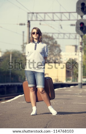 Hipster girl at railways platform.
