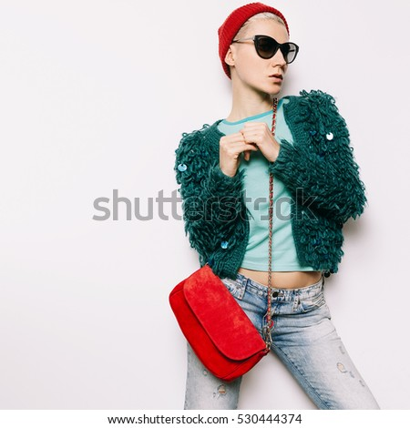 Hipster Girl Autumn Winter style trend. Fashionable knit coat and beanie stylish red clutch. Combination Red and Green.