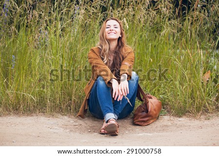 hipster girl sitting on the road