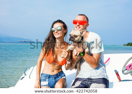 Hipster girl, speed boat, Glamorous tanned Model in fashionable Swimsuit and stylish Accessories at the beach, American flag. California beach, west coast. sexy tanned slim body, wet skin