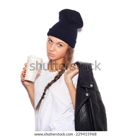 Hipster girl  with cup of coffee. Close-up lifestyle indoor portrait, not isolated