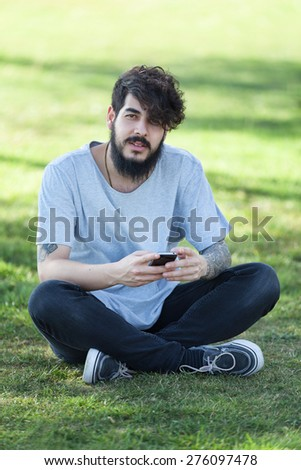hipster guy with tattooed arm using a laptop.focus on keyboard - stock photo