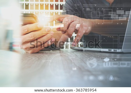 hipster hands using smart phone and laptop computer with digital design diagram layer on wooden desk as concept - stock photo