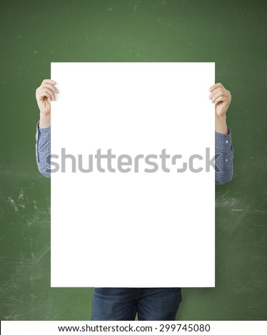 hipster holding blank poster on concrete floor - stock photo