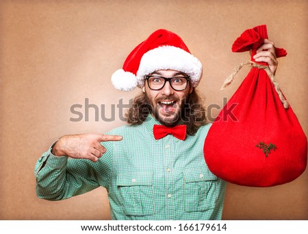 hipster in Santa Claus clothes with the socks of the presents